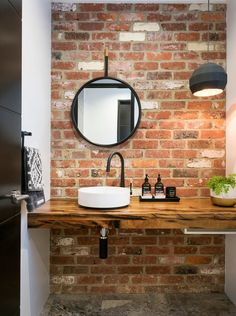 Houzz.com. Urban lifestyle. Natural wood countertop, brick accent wall.