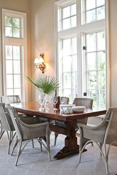 Bringing the exterior into the interior. Cane chairs ! On holidays, the trestle table comes to the center of the room; two 24-inch leaves and extra cane chairs make room for more. Palm fronds take the place of fussy floral bouquets.