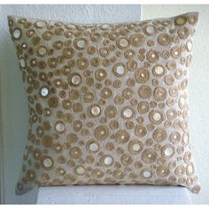 Pillow Sham Cover is made using a Natural Color Cotton Linen fabric which has been intricately embroidered with natural Jute thread in concentric small circles. The circles are highlighted with Mother Of pearl. Using all natural materials this design is totally Jute Centric. The back of the Pillow Sham is the same Natural Color Linen with a flap covered zipper for clean look and easy removal. Pillow Sham Cover Size - 24 x 24 inches. Other Size Options are also available in this Design. 16x16…