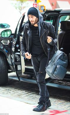 Stylish as ever: Zayn was dressed down in a rock 'n' roll ensemble, donning a…
