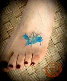 Watercolor/origami tattoo by Koray Koragozler. Tattoo artist in Istanbul, Turkey.