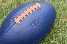 Leather Head Big Blue football. (F1-BB-Red)   The best seller among our colored footballs. The vibrant blue color is great on display, but this football is also built for play.  LEATHER HEAD™ footballs are American footballs that stand apart. Carefully crafted, one at a time from individually selected hides, each LEATHER HEAD™ football is unique.  LEATHER HEAD™ footballs are made in the modern style. To enhance grip, they are made slightly smaller than an official league football…