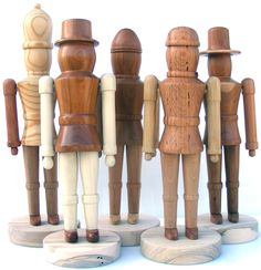 Turned Wood Nutcrackers; [not sure exactly what they are, but not nutcrackers. Nutcrackers must, at least, feign a nutcracking mechanism. Kind of cute, though.]