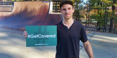 Dan Foley holding #GetCovered sign. Raleigh, North Carolina.