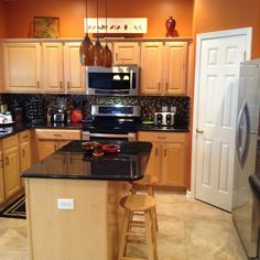 My orange kitchen! Black and white painted two-tone cabinets ...
