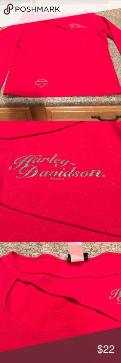 Harley-Davidson women's shirt -size large This shirt is smoking hot!!! Red, with sparkle and an amazing cut out!! 18 inch pit to pit lying flat non-stretch, and 21 inches total length. Harley-Davidson Tops