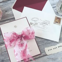 How to make luxury laser cut invitations in burgundy and gold diy wedding invitation with organza bow pretty wedding invitation to make yourself diy wedding stopboris Image collections