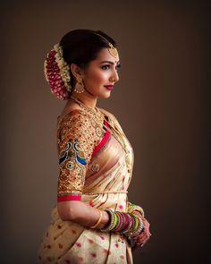 South Indian bride. Gold Indian bridal jewelry.Temple jewelry. Jhumkis. Cream gold silk kanchipuram sari. Bun with fresh flowers. Tamil bride. Telugu bride. Kannada bride. Hindu bride. Malayalee bride.Kerala bride.South Indian wedding. Pinterest: @deepa8