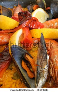Paella - Traditional spanish rice with mussels, prawn and red pepper by MilaCroft, via ShutterStock