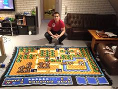 """Super Mario 3 fan Kjetil Nordin spent 800 hours over 6 years to make a perfect crocheted copy of the game's first map. The 31 year-old Norwegian used 100 balls of yarn, and the impressive blanket measures 2.2 by 1.8 meters (7'2""""x5'10""""). Kjetil even redid a massive section when he realized he had used an imperfect color for a certain portion of the map."""