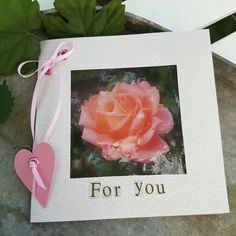 """A card from my book """"Kreative kort og mærkater """". The photo of the rose is printed on transparent paper and laminated before used as a part of my greetingcard."""