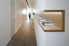 Add a long shelf to a hallway.