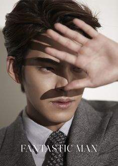 GUY CANDY: Video and photos of Kim Woo Bin in a sexy suit