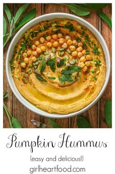 A fun twist on hummus, this spiced pumpkin hummus recipe takes minutes to make and is so delicious! There's pumpkin purée, pumpkin pie spice and other goodies for a tasty treat. Enjoy this flavoured hummus with veggie sticks or your favourite chips. #pumpkinhummus #flavouredhummus #hummusrecipe #recipeusingpumpkinpuree #creamyhummus #pumpkinpiehummus