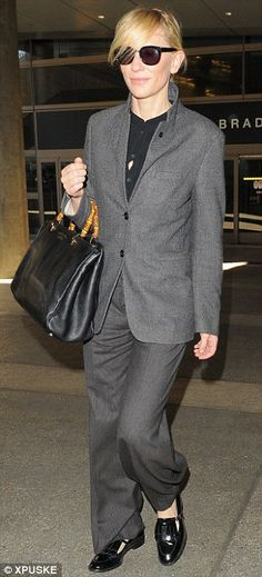 No shrinking violet: Cate Blanchett wore a demure charcoal suit at LAX but still dazzled like a Hollywood star