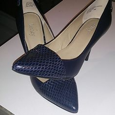 Hot Levity navy heels! Size 6M Almost brand new smokin hot Levity heels. Size 6M. Navy blue. Had beautiful design on the toe and super cute lace up on the back. Levity Shoes Heels