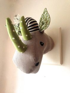 Quirky rhino head trophy. Circus animal - vegetarian wall art. Textile wall hanging. Fauxidermy.