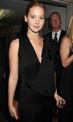Jennifer Lawrence - wears no makeup to a movie premiere.  Finally someone in Hollywood shows how beautiful we can be WITHOUT painting our faces.  So many women look just as beautiful as her without makeup.  She's also known for wearing very minimal makeup to events, letting her natural beauty shine through instead of hiding it.  I hope her confidence is catching.
