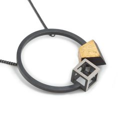 Oxidised sterling silver pendant with ebony and gold leaf detail  Pendant diameter 35mm, chain length 42cm