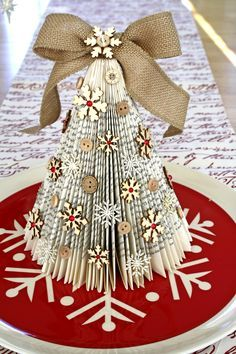 A lovely rustic Christmas tree made from old book pages and decorated with beautiful wooden snowflakes and buttons from Cocoa Daisy!                                                                                                                                                                                 More