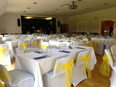 Yellow chair sash with blue swag at Horton Village Hall