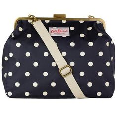 This classic handbag is perfect if you prefer a smarter option. It has a vintage-style frame closure with an adjustable shoulder strap and is finished in our durable matt oilcloth. The bag is completed with a printed cotton lining - don't really like polkadot, but this one is so cute