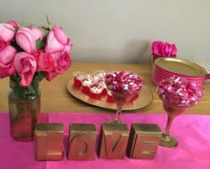 Valentine's Pink and Gold Party Simple decorations. Used spray paint to create gold letters! Plus spray painted the jar and glasses with gold on the bottom.