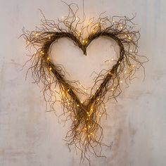 Wild and wonderful, this heart-shaped wreath is formed by an abundance of curly willow twigs. Beautiful when displayed alone, it also welcomes glowing lights and seasonal adornments.- Curly willow, metal base, floral wire- Indoor use only- Willow Wreath, Heart Wreath, Grapevine Wreath, Heart Shaped Wreath, Valentine Wreath, Valentine Decorations, Valentine Box, Valentine Ideas, Valentine Crafts