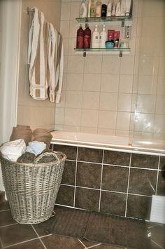 VillaPaprika - basket on floor with rolled towels (no towels inside shower like pictured)