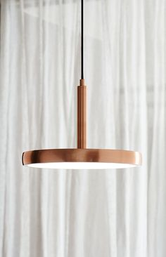 The Beacon Lighting LEDlux Bennett 300mm dimmable LED pendant with colour shift technology in copper finish.