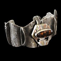 """Emilie Cohen & Michael Pundy, Canton, CT, cohenpundy.com """"Fire Agate Cuff,"""" sterling silver and copper woven inlay with fabricated silver, copper and brass lamination with Fire Agate. Emilie Cohen & Michael Pundy"""