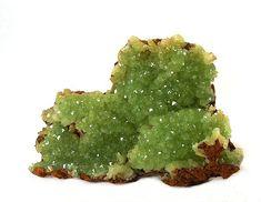 ADAMITA ó ADAMIDA. Es unmineralconstituido porarseniatodezinc. Se encuentra habitualmente en zonas deoxidacióno humedad sobre menas de zinc. Habitualmente es de color amarillo, pero se tiñe de verde por inclusiones decobre.