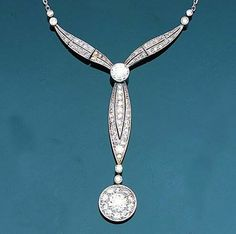 An early 20th century diamond necklace, circa 1910  The articulated pierced ribbon, millegrain-set with old brilliant and single-cut diamonds, terminating in an old brilliant-cut diamond circular cluster drop, to a trace-link back-chain, Dutch assay mark, length of pendant 6.5cm., length of back-chain 40.0cm.