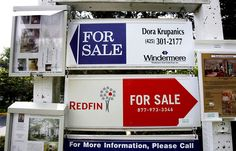 HOME SALES IN SEATTLE AREA 080608   These signs in Issaquah point the way to home sales.