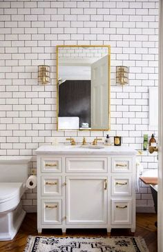 I think I'm really diggin' the white subway tile/gray grout/gold fixtures look!