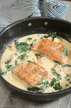 Creamy Garlic Salmon and Shrimp (Video) - Cooked by Julie Creamy and delicious salmon and shrimp cooked in a garlic cream sauce. This tuscan inspired seafood dish is versatile and can be served with the starch of your choice. Salmon And Shrimp, Salmon And Rice, Garlic Salmon, Butter Salmon, Salmon Cream Sauce, Fish With Cream Sauce, Salmon With Cream Sauce, Garlic Spinach, Baked Salmon Recipes
