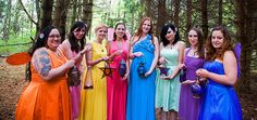 Rainbow wedding party with different dresses, lanterns, and fairy wings!