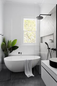 Home Interior Decoration Modern Scandinavian bathroom interior in black and white.Home Interior Decoration Modern Scandinavian bathroom interior in black and white Modern Farmhouse Bathroom, Farmhouse Design, Farmhouse Decor, Farmhouse Style, Modern White Bathroom, Modern Bathtub, White Bathrooms, Farmhouse Remodel, Modern Bathrooms
