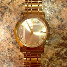Burberry Gold Watch Have worn for the last year, in good condition, does show a little wear which is normal. I have a small wrist, I may have the extra links somewhere but it's no guarantee. Burberry Accessories Watches