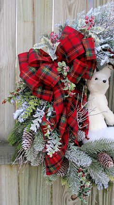 Perfect November-February, this beautiful Woodland Winter Wreath features a gorgeous 11.5 tall sisal Arctic Fox surrounded by top quality snowy greenery, iced winter branches, perfectly accented with iced berries and a cozy red flannel plaid tartan bow! **Measures: 30T x 27W x 7D