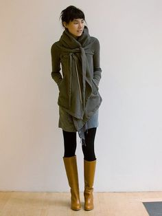 Gray sweater coat with black leggings and mustard boots