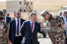 King Abdullah II of Jordan, center, speaks with a Jordanian army soldier during a visit by U.K. Prime Minister Theresa May, to a Jordanian Army Base in Zarqqa, Jordan, on Monday, April 3, 2017. May began a visit to Jordan and Saudi Arabia on Monday, with the goal of building security and commercial ties. Photographer: Simon Dawson/Bloomberg via Getty Images