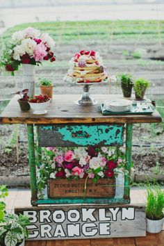 Rustic urban cake display with a naked wedding cake #wedding #rustic #urban #weddingcake #weddingdecor