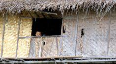 child peeks from window inle lake floating village - #Myanmar