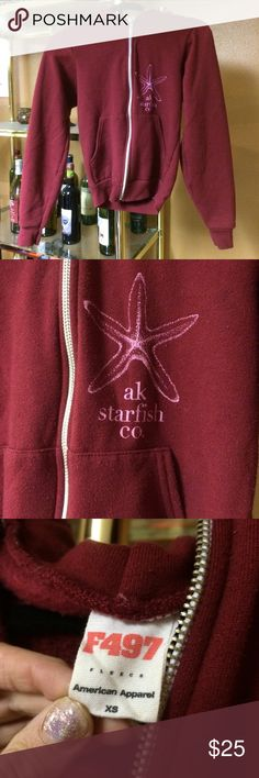 """Burgundy Alaska Starfish Co. zip up hoodie Burgundy zip up hoodie with pink """"Alaska Starfish Co."""" detail written on the front and back, size xs, make an offer I am always willing to negotiate on a price , as everything needs to be sold as soon as possible :) Alaska Starfish Co Tops Sweatshirts & Hoodies"""