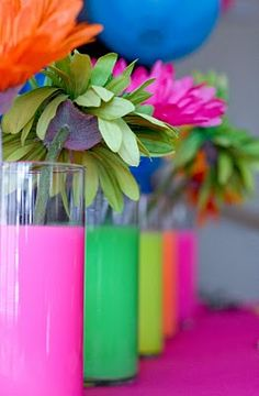 Dollar Tree vases filled with water and drops of neon acrylic paint...dollar tree flowers