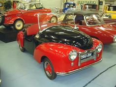 """1951 Atlas Babycar. Introduced as the """"Coccinelle"""" (Ladybird) at the """"Paris Salon"""" in 1949. The prototype was built in 1949, with the well-known 170cc AMC motor, making 8.5 horsepower. An Ilo 250cc engine and an electric starter were considered for its primarily female customers. This is one of the only two examples known to exist."""