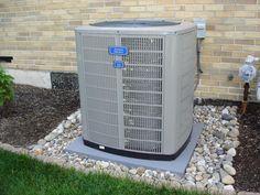 Gravel/rock around air conditioner slab