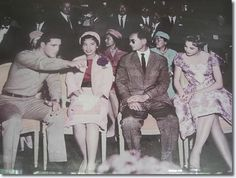 Elvis meets the King and Queen of Thailand. From L to R. The King, the Queen, and the King.