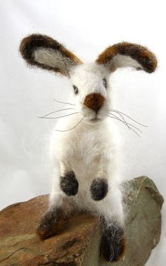 This adorable bunny is 7 inches tall from his feet to the tip of his ears. He was needle felted over a strong wire armature making his front and